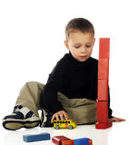 Tumbling Tower with School Bus Royalty Free Stock Image