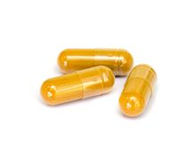 Tumeric capsule. royalty free stock images