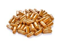 Tumeric powder capsules Royalty Free Stock Images