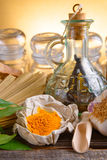 Tumeric powder and other herbs stock photos