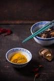Tumeric powder and shiitake mushrooms Royalty Free Stock Images