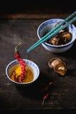 Tumeric powder and shiitake mushrooms Stock Photography