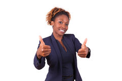 Tummar för danande för afrikansk amerikanaffärskvinna gör en gest upp - svart Arkivbilder