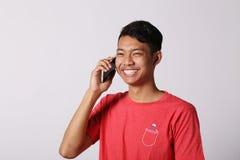 Tummar up den asiatiska pojken Arkivbilder