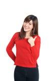 Tummar up kvinnan i rött Royaltyfria Foton