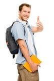 Tummar upp lycklig man för student Fotografering för Bildbyråer
