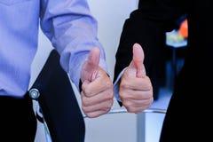 Tumme för två händer upp för affär Royaltyfri Bild