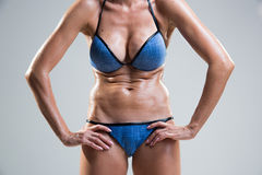 Tummy cellulite. poor posture. Large breasts.  light background Royalty Free Stock Images