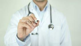 Tumore dello stomaco, il dottore Writing sullo schermo trasparente stock footage
