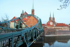 Tumski Bridge in Wroclaw (Lovers bridge). Tumski Bridge across the Oder river in Wroclaw, Poland. The Tumski Bridge is also called Lovers Bridge. The bridge is Stock Photo