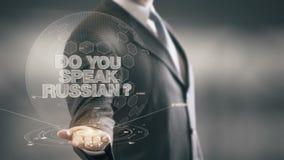 Tun Sie Ihr sprechen russische neue Technologien Geschäftsmann-Holding in der Hand stock video footage