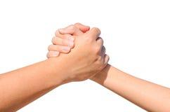 Tun Sie sich Hand zwischen einem Mann und einer Frau zusammen, die auf Weiß lokalisiert werden Stockfotografie