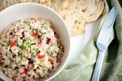 Tuna and avocado salad served in a bowl with ciabatta toasts. And green napkin Stock Photos
