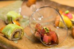 Tuna Avocado Sushi Maki and raw salmon Royalty Free Stock Images