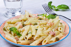 Tuna, basil and caper penne. Stock Images
