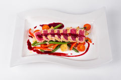Tuna with berry sauce, vegetables, tomatoes, green bean and chil Royalty Free Stock Images
