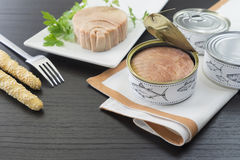 Tuna with breadstick and can. Fresh and soft canned tuna on the wooden table, with breadstick and can stock images