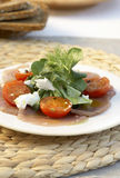 Tuna carpaccio. With tomatoes, cheese and corn salad stock images