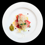 Tuna carpaccio on plate isolated over black Royalty Free Stock Photo