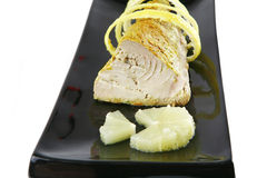 Tuna chunk served with lemon Stock Photos