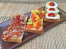 Tuna corn salad and boiled eggs sandwiches Stock Image