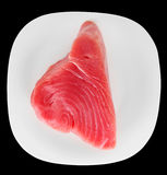 Tuna fillet on plate, isolated on black Royalty Free Stock Photos