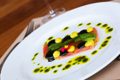 Tuna fillet with sauce on plate Royalty Free Stock Photo
