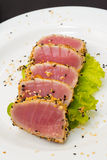 Tuna fillet on white dish with salad and soy sauce Stock Photos