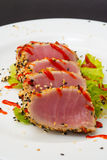 Tuna fillet on white dish with salad and soy sauce Stock Image