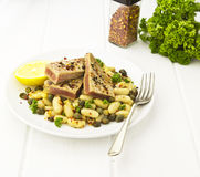 Tuna fillets on bean salad Royalty Free Stock Images