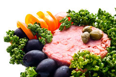 Tuna fish with black olives, tomatoes, capperis  and parsley clo Stock Photos