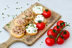 Tuna fish Bruschetta sandwich with cottage cheese. Healthy  Tuna  fish organic  sandwich with bruschetta, fresh onion  and  cherry tomatoes Royalty Free Stock Photography