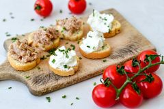 Tuna fish Bruschetta sandwich with cottage cheese. Healthy  Tuna  fish organic  sandwich with bruschetta, fresh onion  and  cherry tomatoes Royalty Free Stock Images