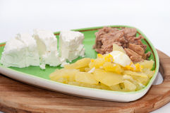 Tuna fish with potatoes and feta cheese Royalty Free Stock Image