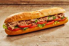 Tuna fish and salad baguette on wood Royalty Free Stock Image