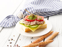 Tuna Fish Salad Sandwich. With Caper, Cucumber, Cheese, Lettuce and Tomato on White Wooden Table. Shallow focus stock image