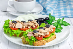 Tuna fish sandwiches on the white plate. And coffee Stock Photo