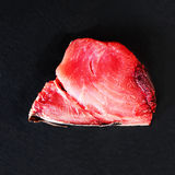 Tuna fish Steak on black background, close up. Royalty Free Stock Image
