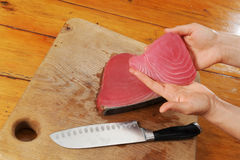 Tuna fish still life. Tuna being exposed by woman hands royalty free stock photos