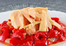 Tuna loins with red peppers. Stock Images