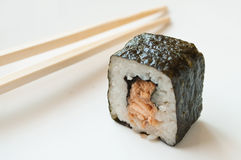 Tuna maki  and chopsticks Royalty Free Stock Images