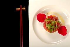 Tuna, mango and cucumber tartare with chop sticks Stock Images