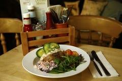 Tuna mayo jacket potato served with fresh salad Royalty Free Stock Photos