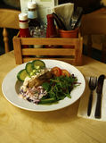 Tuna mayo jacket potato served with fresh salad Stock Photo