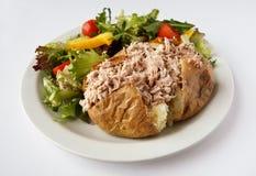Tuna mayo Jacket Potato with side salad. Tuna mayonnaise baked potato on a plate with side salad Stock Photography