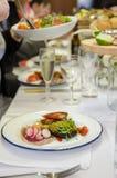 Tuna, mushroom and salad. Served at the venue Royalty Free Stock Image