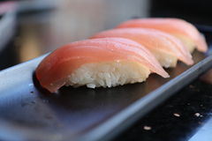 Tuna nigiri sushi. Three tuna nigiri sushi on a black plate Stock Photography