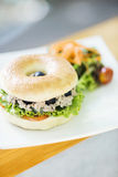 Tuna and olive bagel with mixed salad Stock Image