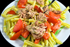 Tuna pasta. With tomatoes on white plate Stock Photos