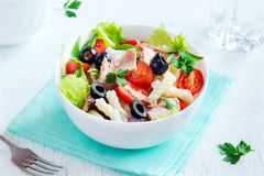 Tuna and pasta salad. With fresh tomatoes, olives, herbs close up stock images